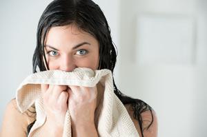 Почему после стирки полотенца воняют